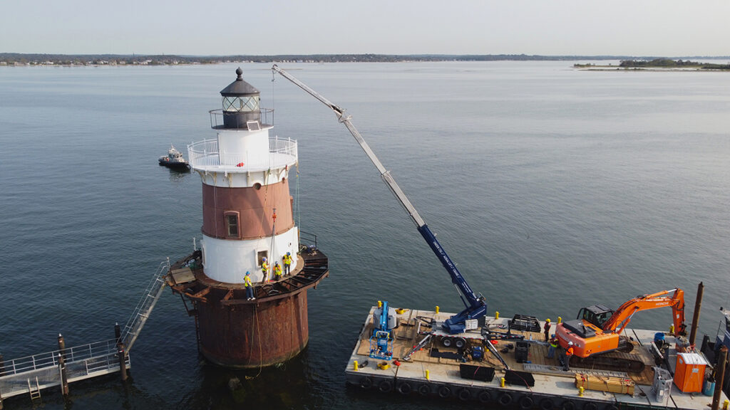 Crane work on lighthouse from barge